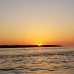 Sunrise in lighthouse Fishing Charleston 101 LLC 20180510